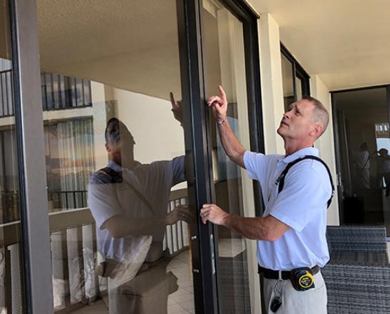 Building Envelope Expert, Chris Matthews, conducting on-site inspection